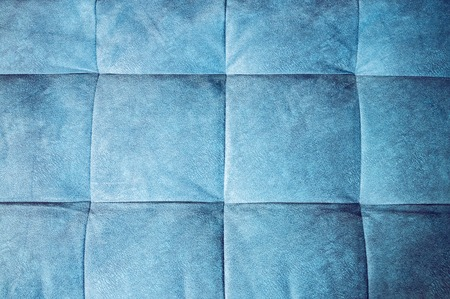 Close-up comfortable blue soft back of the sofa with curly stitching. Modern design 스톡 콘텐츠