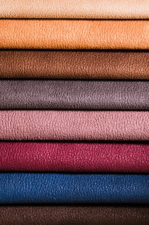 A set of samples of fabric furniture decoration lines of textile textures. Multicolored stripes upholstery. Mode and tone for a luxurious interior style. Abstract background