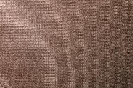 Gestructureerde achtergrond grote bruine textiel. Textuur van textiel stof close-up