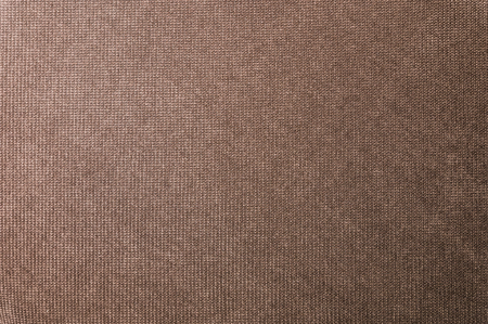 Textured background large brown textile. Texture of textile fabric close-up