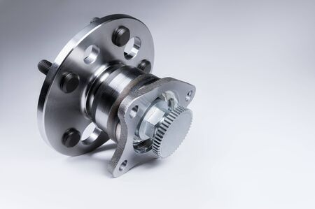 New Wheel hub assembly with bearing. This is part of the car suspension on a gray background with a gradient. The concept of new car parts Stock Photo