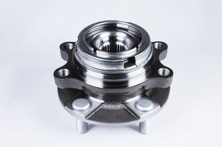 New Wheel hub assembly with bearing. This is part of the car suspension on a gray background with a gradient. The concept of new car parts Stock fotó