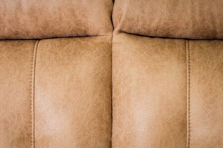 Close-up the Fragment of expensive beige leather sofa to indoors Banco de Imagens