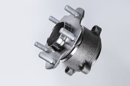 New Wheel hub assembly with bearing. This is part of the car suspension on a gray background with a gradient. The concept of new car parts. 스톡 콘텐츠