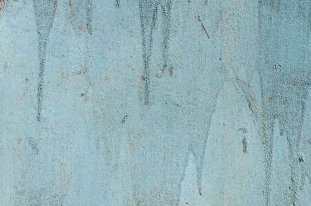 Light blue faded. Texture of stained metal surface with cracked paint with cracked paint. Finely detailed background.