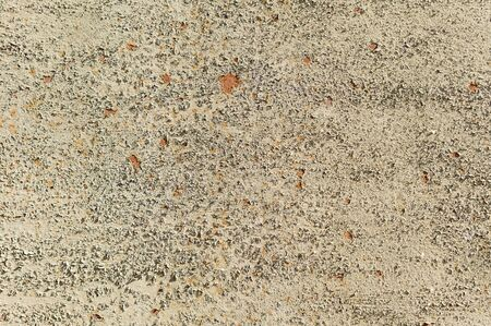 Beige Texture of painted metal surface with cracked paint. Finely detailed background.