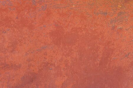 Fine texture of a rusty metal surface once painted red