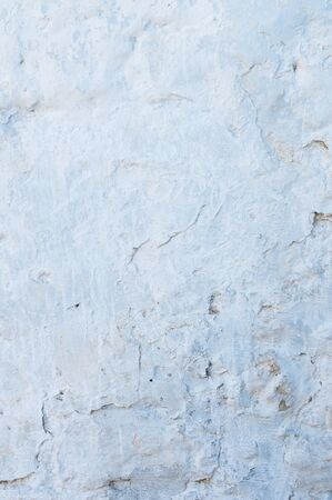 Blue plastered repeatedly brick wall texture. Whitewash Brick wall facade building surface. White wash abstract background.