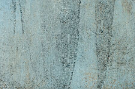 Light blue faded. Texture of stained metal surface with cracked paint with cracked paint. Finely detailed background