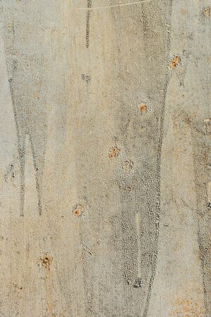 Light yellow faded. Texture of stained metal surface with cracked paint with cracked paint. Finely detailed background