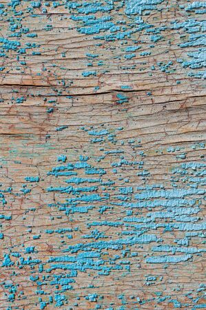 Old and peeling paint Over time, the blue paint peeled off from the old boards and the wood texture cracked. Vintage Abstract Grunge Background