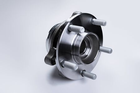 New Wheel hub assembly with bearing. This is part of the car suspension on a gray background with a gradient. The concept of new car parts.