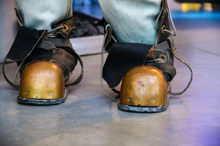 Close-up shoes of an old vintage three-bolt deep-sea diving suit. Suit for deep sea diving of the last century. The history of the study of the underwater world