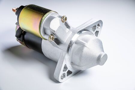 Starter of an internal combustion engine New Spare part for car on a gray background