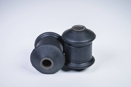Classic silent blocks car suspension kit one pair on a gray background. Rubber parts with metal bushings.
