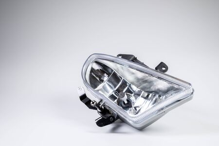 New spare parts for the car. Recessed fog lamp on a gray background. Archivio Fotografico