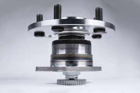 Spare parts new abs front car suspension hub on a gray gradient background assy. Kit for repairing the bearing suspension Stok Fotoğraf