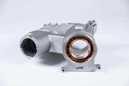 Ignition lock housing with steering shaft bearing on white background