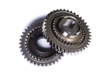 Two gears from car gearbox on white isolated background
