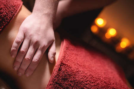 Belly massage. Close-up of the hands of a professional masseur massaging the abdominal cavity Stok Fotoğraf