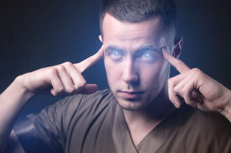 Caucasian man with glowing eyes reads your mind. Makes you suggestion and telekinesis