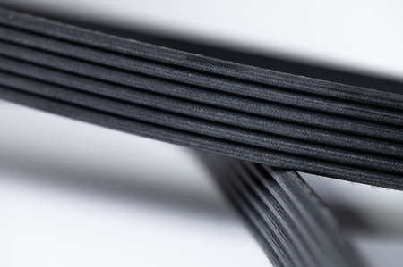 New belt for automobile poly-V-belt electricity generator. Macro close-up blank for background