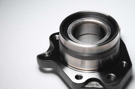 auto hub bearing new on gray background. metal spare part for front suspension