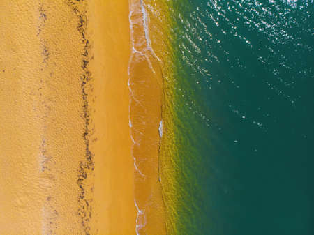Aerial view of sunny golden beach with turquoise water top view Stock fotó
