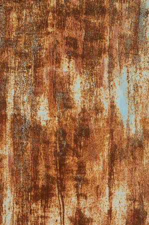 Textured grunge background red peeling paint with rust on old metal surface