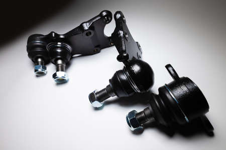 front suspension ball joint new on gray background. Spare parts kit for SUV
