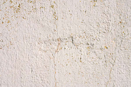 Grunge gray background of cracked peeling walls with peeled putty in beige tones. Stock fotó