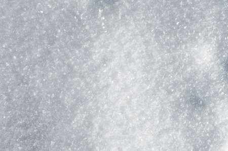 Large crystals on the snow surface on a sunny winter day. Winter background