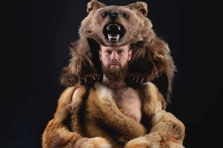 Low key portrait of a bearded military shaman in bearskin. High quality cosplay of the ancient werewolf war Stockfoto