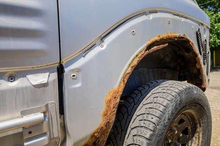 Rusty wheel arches on the car. car corrosion. Background for welding work on the restoration of the car body