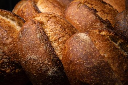 Freshly baked hot loaves of crispy artisan bread close-up. Healthy foods and proper nutrition Zdjęcie Seryjne