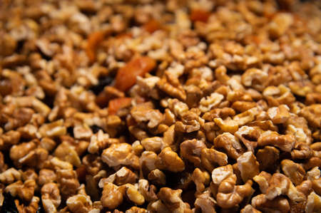 Dried mixture of walnuts and dried fruits close-up. Mix for adding to baked goods. Healthy vegan food Foto de archivo