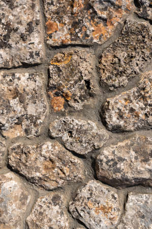 Background. Stone wall texture. The shell rock material is bonded with cement mortar Foto de archivo