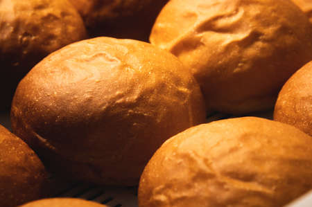 Freshly baked hot loaves of crispy artisan bread close-up. Healthy foods and proper nutrition Foto de archivo