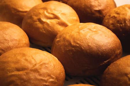 Close-up background of hot fresh hamburger buns. Artisan buns