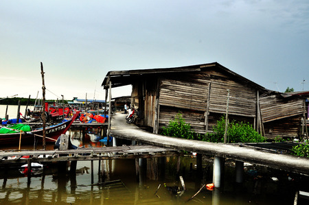 fishing huts: Pasir Penambang,Malaysia  April 18 2015 : Old fishing huts Editorial