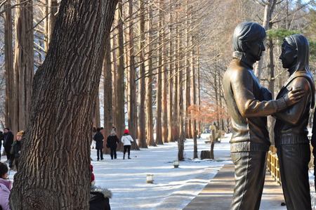 sonata: Namiseom,South Korea 1 Jan 2015: Famous statue of  Winter Sonata actor and actress in Nami Island Editorial