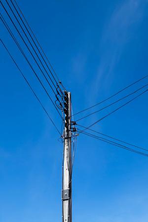 electricity pole: Electricity pole with blue sky background Stock Photo