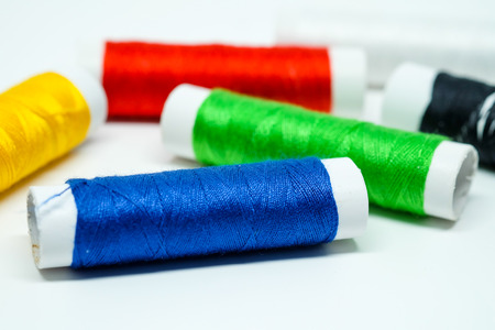assignments: Colorful thread rolls focused on blue thread rolls