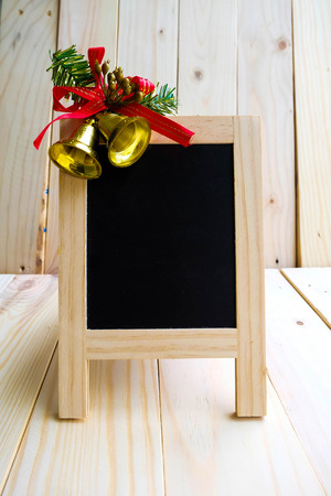 christmas bells: Blackboard sign with Christmas bells decoration Stock Photo