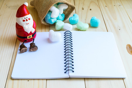 clause: Santa Clause and blank notebook with sack of blue white heart