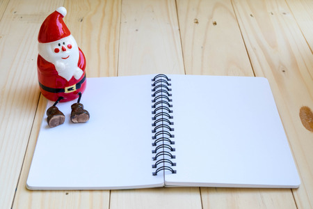 clause: Santa Clause and blank notebook Stock Photo