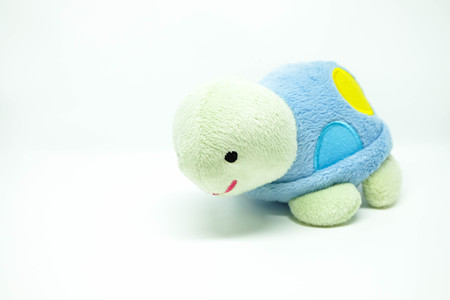 green turtle: Green turtle with blue carapace doll Stock Photo