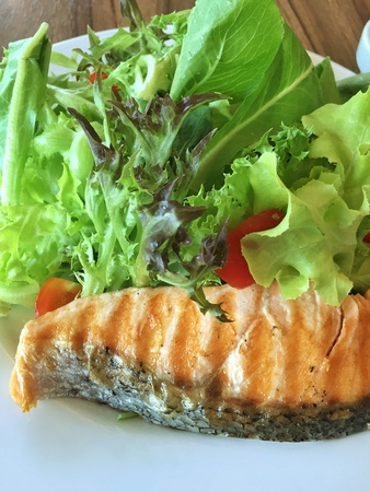 close: Yummy healthy grilled salmon in close up