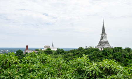 phetchburi: Phra Thart Chompetch is the white pagoda on the right hand side. The left hand side is  Wat PhraKaewnoi and Red Pagoda. All of them is a part of Phra Nakorn Khiri Historical Park. Stock Photo