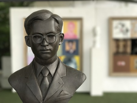 formal attire: December 26, 2016 - Bangkok, Thailand: Young King Rama 9 bust in formal attire showed at Tha Maharaj. The exhibition attributed to condole and pay respect to Thai passed away King Rama 9.